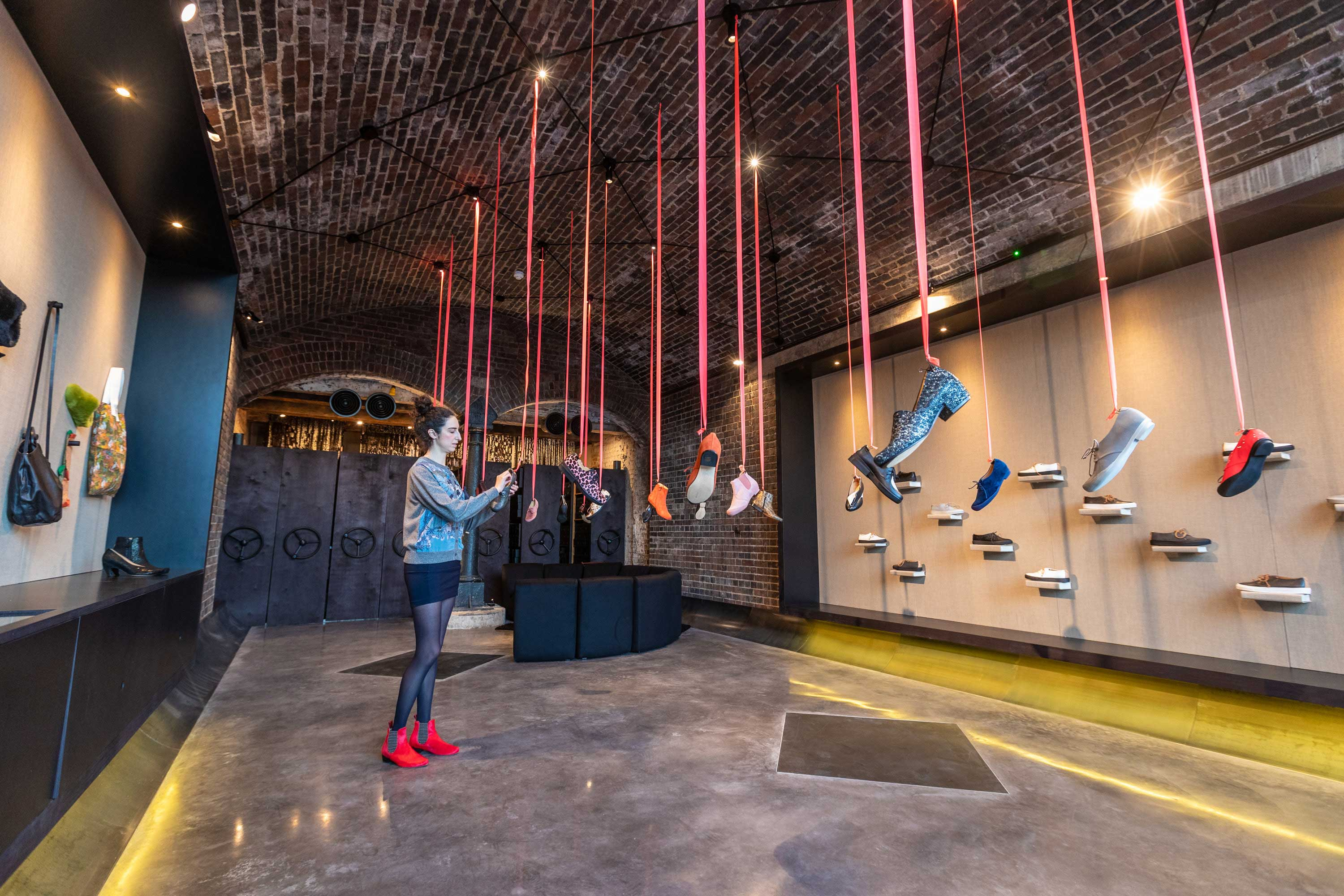 coal drops yard shoes hang from ceiling