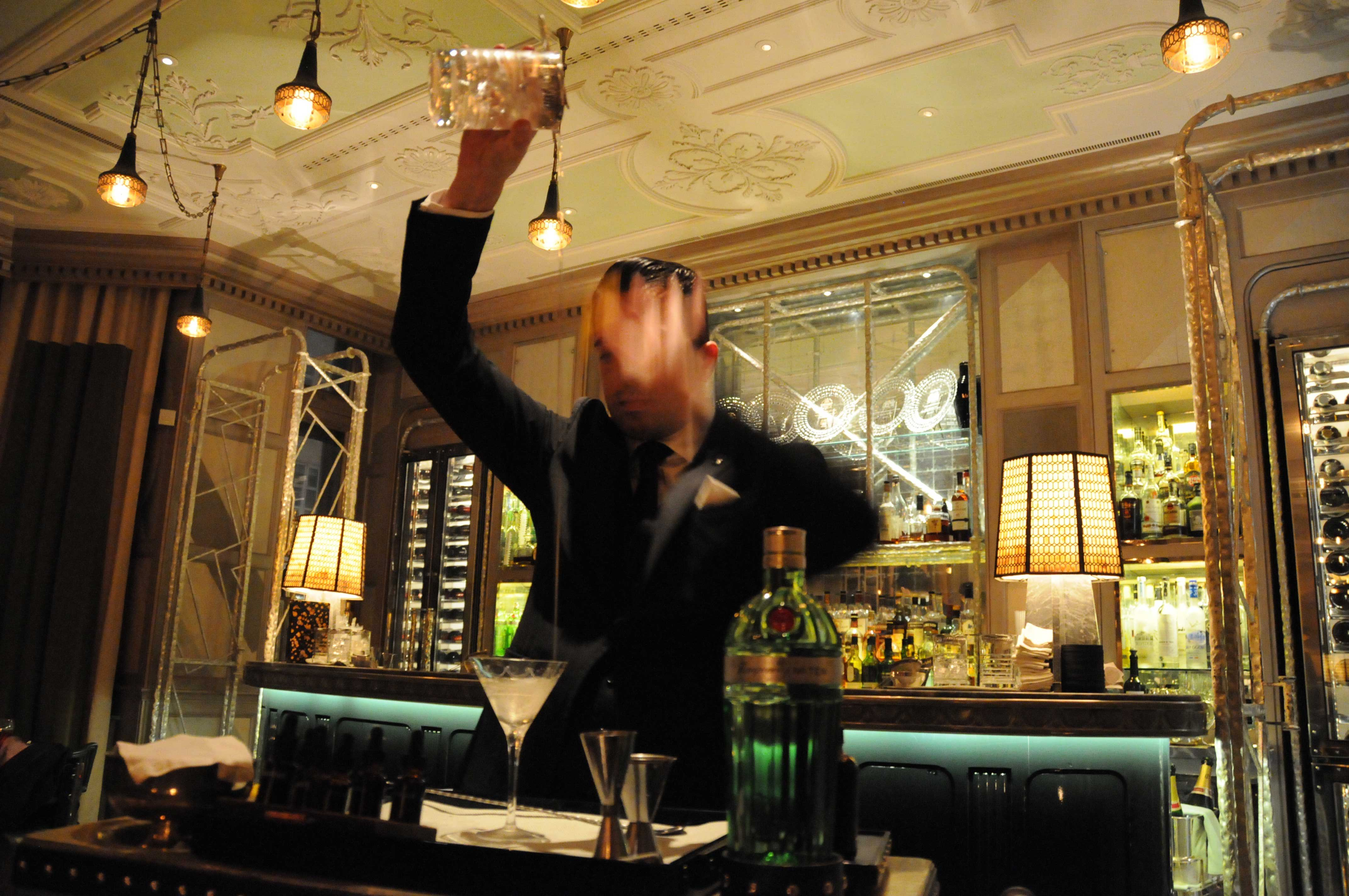 connaught london interiors man pouring drink